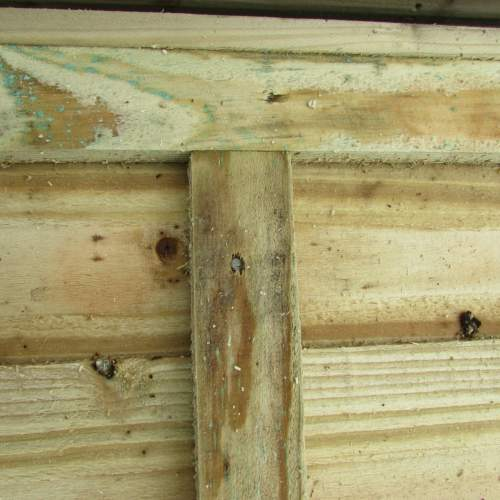 Waney18301830Green--Pressure-Treated-Waney-Lap-Fence-Panel-1.8-x-1.83m-5.JPG